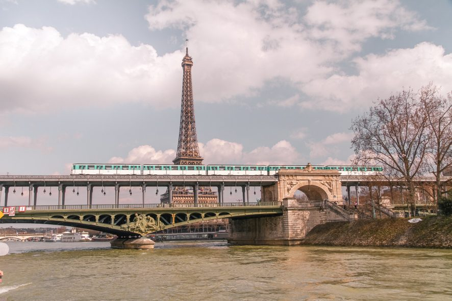 A metro passes in front of the Eiffel tower in Paris