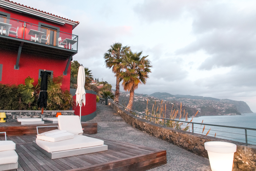 Watch the sunset from the terrace at Estalagem da Ponta do Sol
